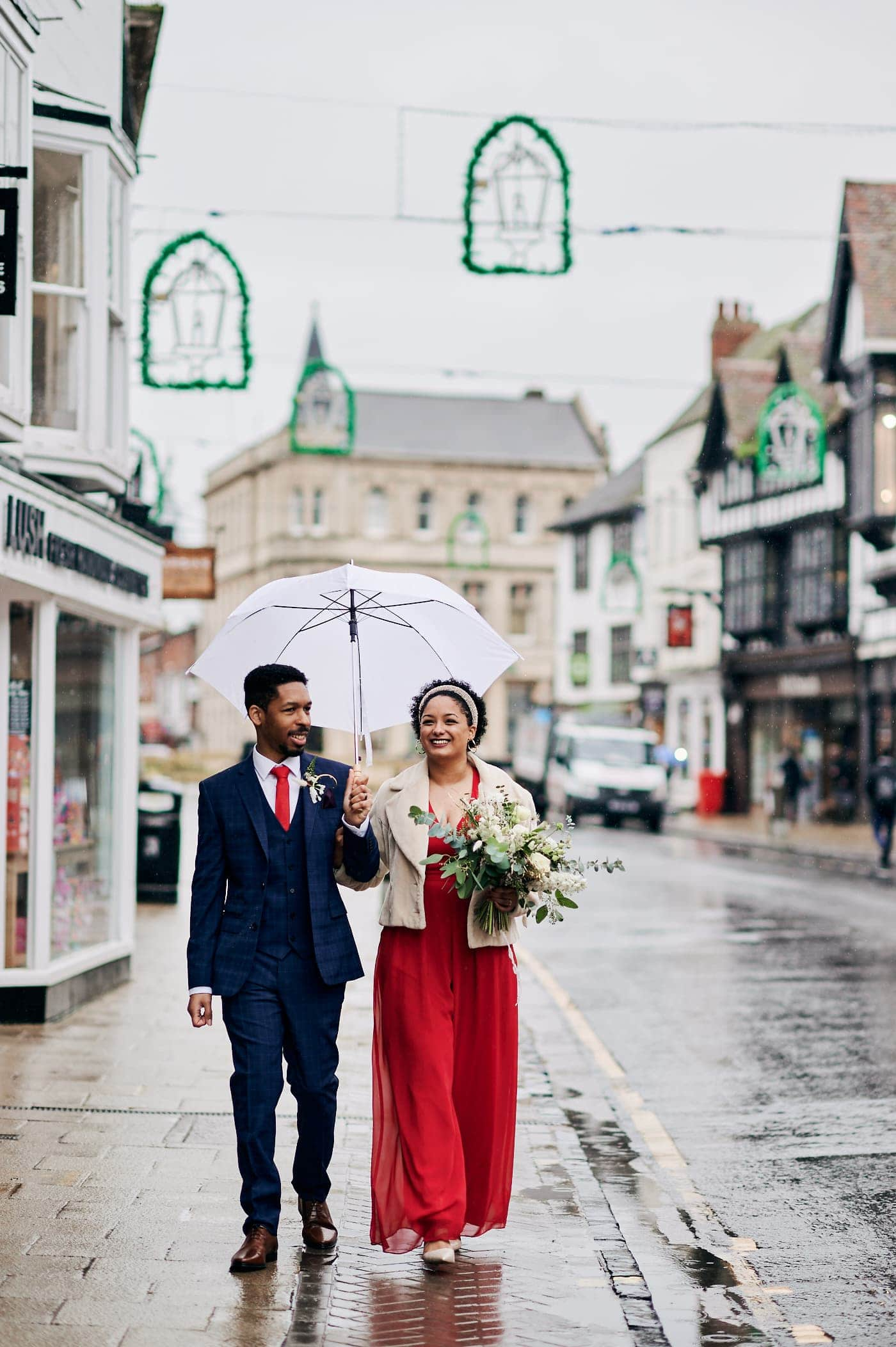 Happy couple walk in Stratford-upon-Avon after small wedding ceremony