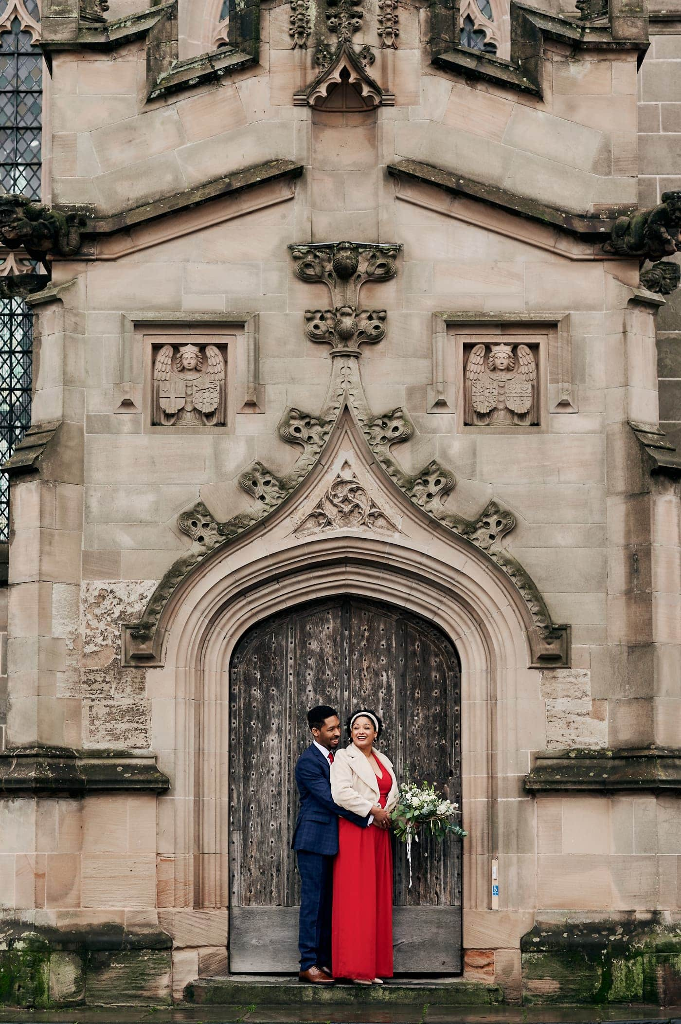 newly married couple in doorway of church in Stratford-upon-Avon
