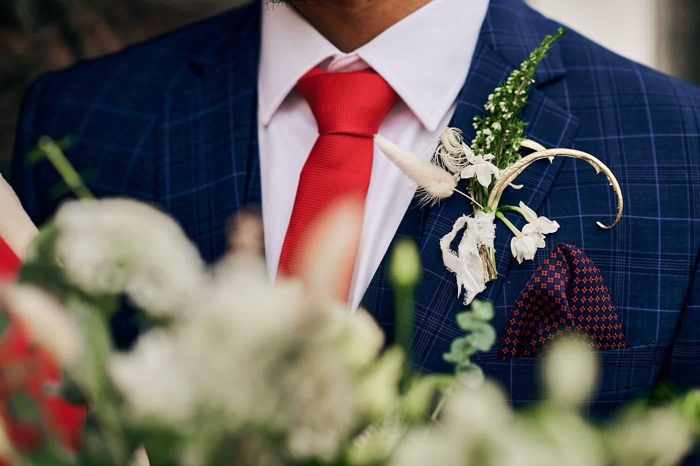 Detail of groom's buttonhole flower