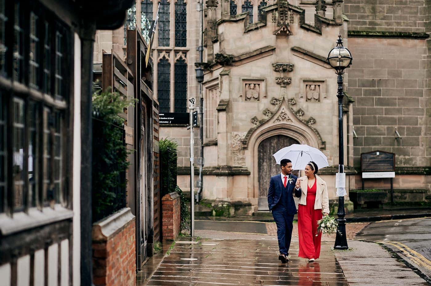 Newly married couple walk in Stratford-upon-Avon