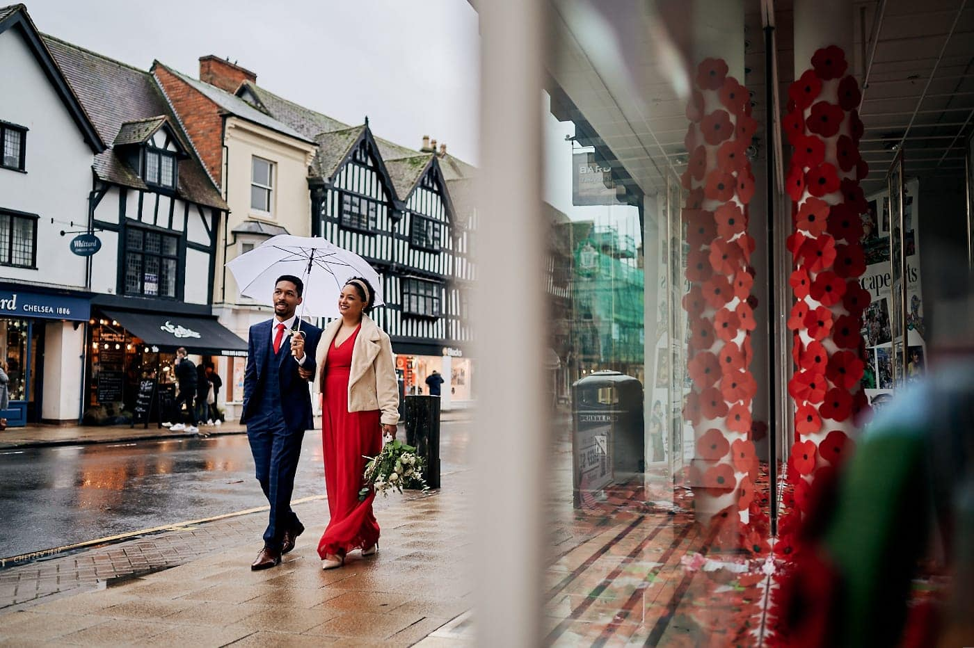Bride and groom walk through streets of Stratford-upon-Avon