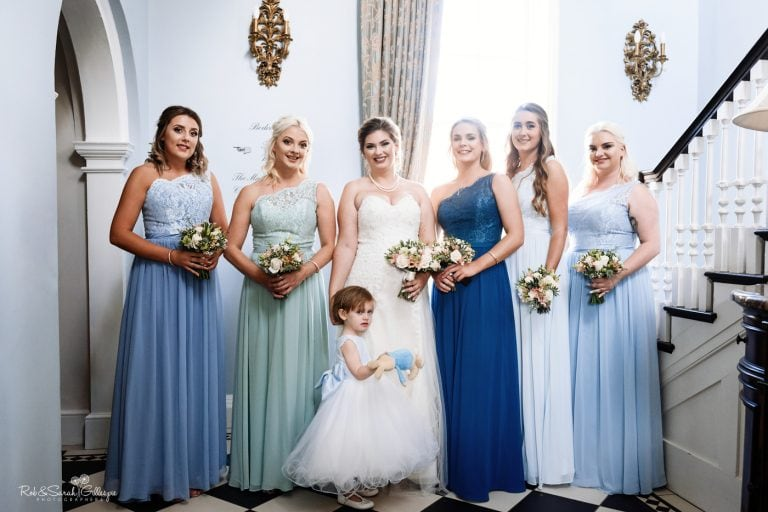 Group photo of bride and bridesmaids in Bride's Manor at Stanbrook Abbey