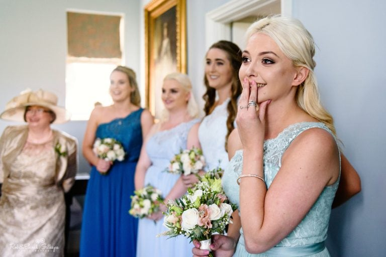 Bridesmaids emotional as she sees bride in her wedding dress