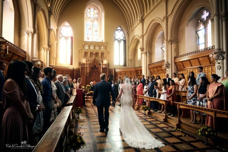 View from rear of Callow Great Hall as bride and father walk up aisle for wedding ceremony