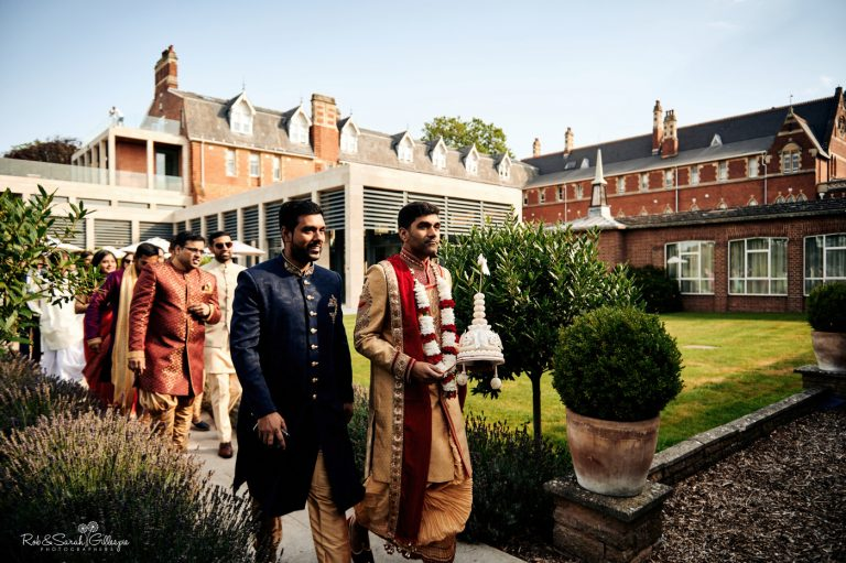 Groom in Indian wedding attire arrives at Stanbrook Abbey for Hindu ceremony