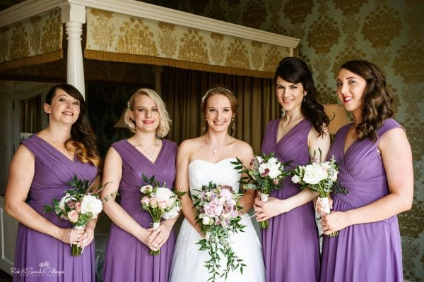 Bride and bridesmaids group photo in bedroom at Warwick House