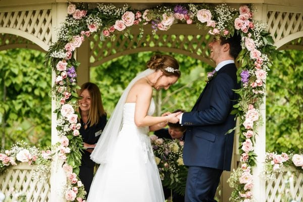 Bride and groom laughing during wedding ceremony at Warwick House