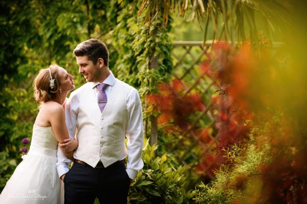 Bride and groom in beautiful gardens at Warwick House on summer evening