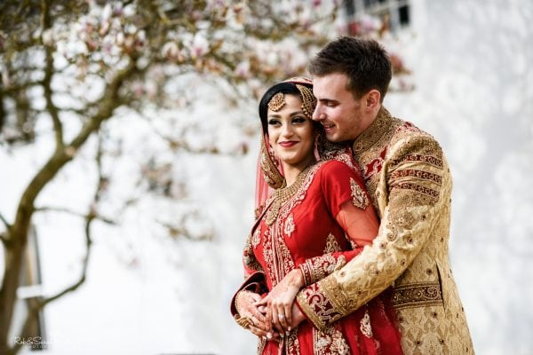 Bride and groom in Bengali wedding outfits at Warwick House