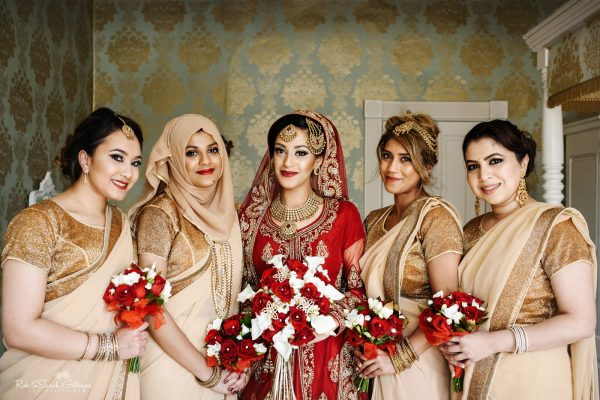 Group photo of bride and bridesmaids in Bengali wedding dresses