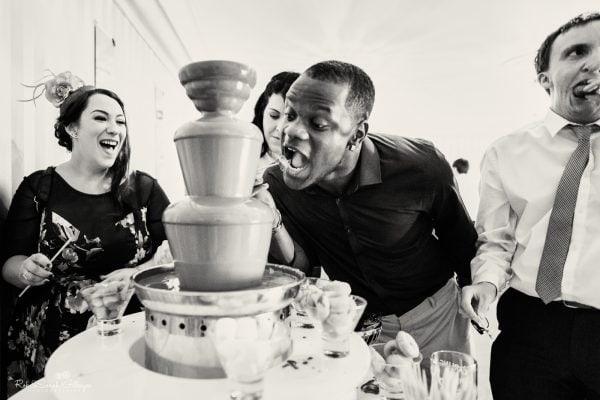 Wedding guests enjoy chocolate fountain