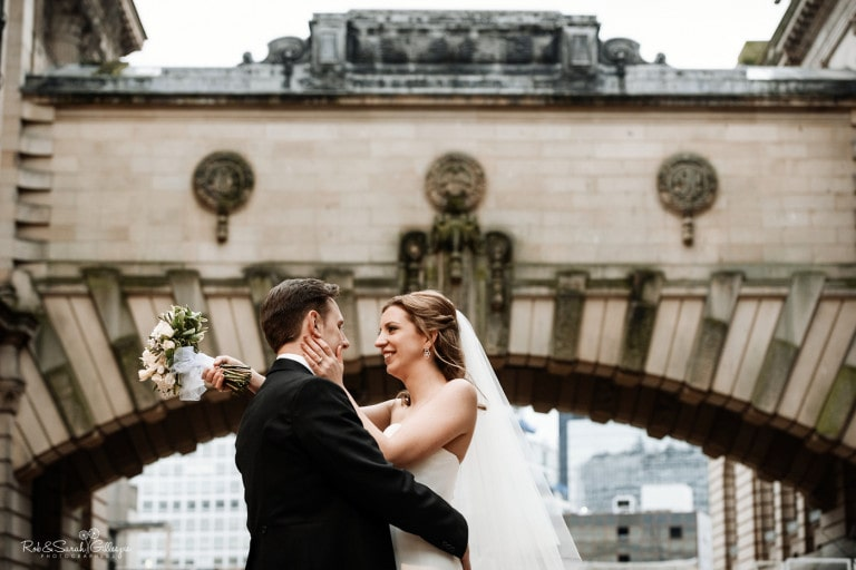 Bride and groom under bridge at Birmingham Art Gallery