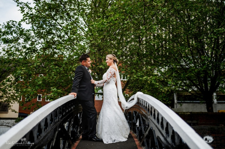 Newly married couple on bridge in Birmingham city centre