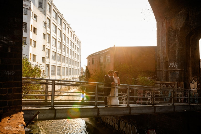 Bride and groom on bridge in Digbeth area of Birmingham