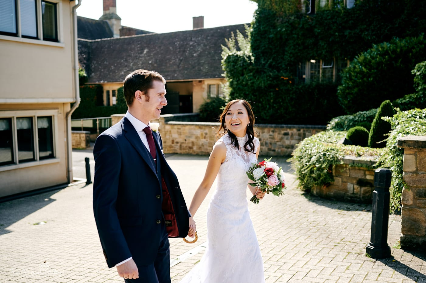 Newly married couple walk hand in hand