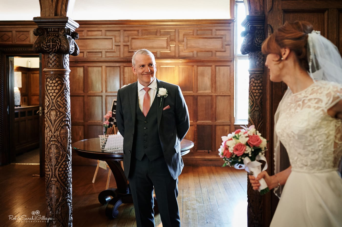 Dad sees daughter in wedding dress in beautiful hall
