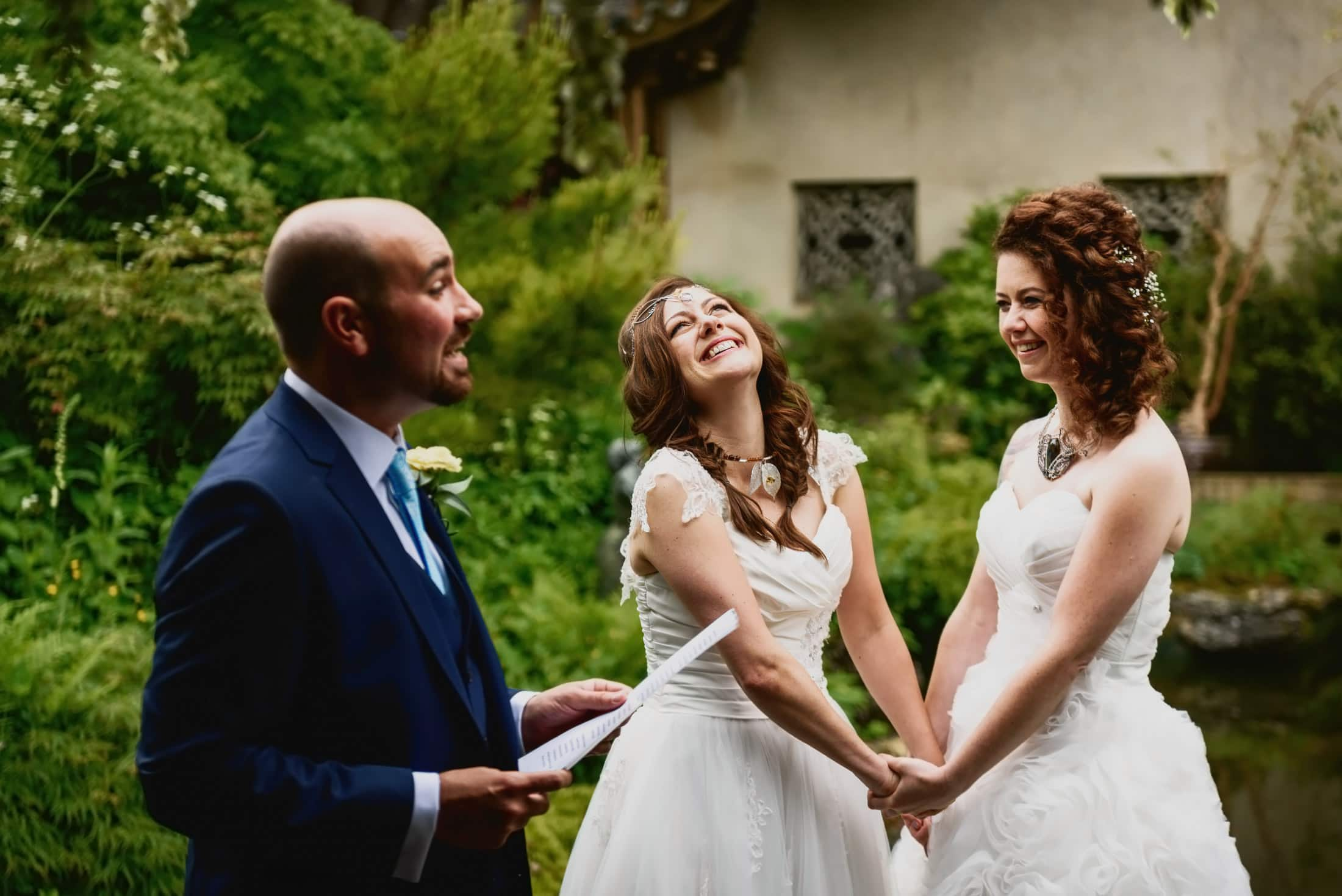 Two brides emotional during wedding ceremony