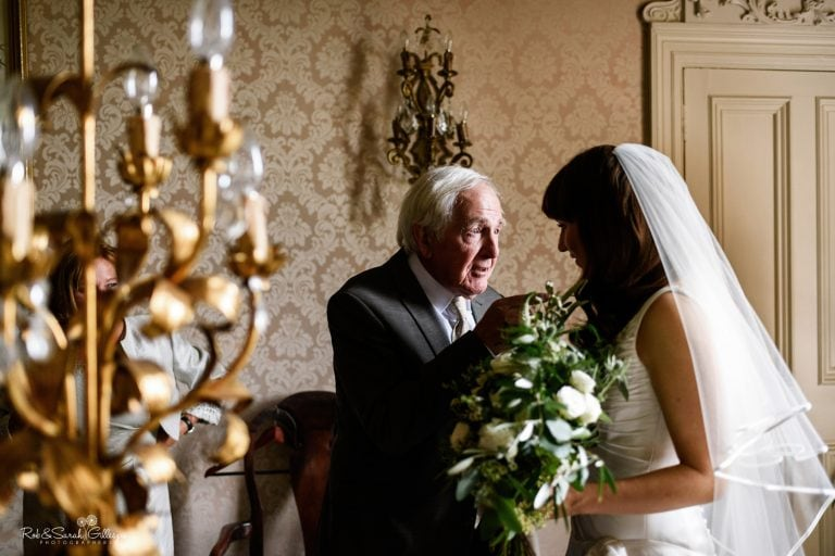 Bride talks with grandfather before wedding ceremony