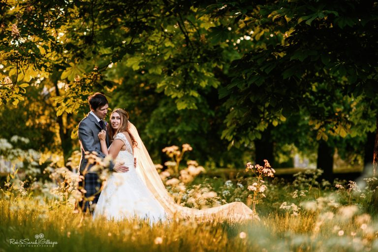 Newly married couple in overgrown gardens at Coombe Abbey with beautiful evening light