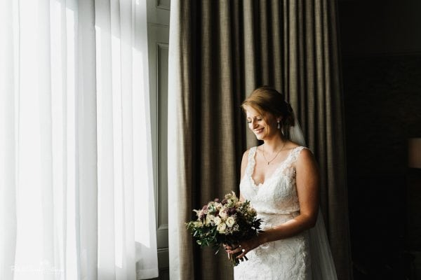 Portrait of bride smiling holding bouquet