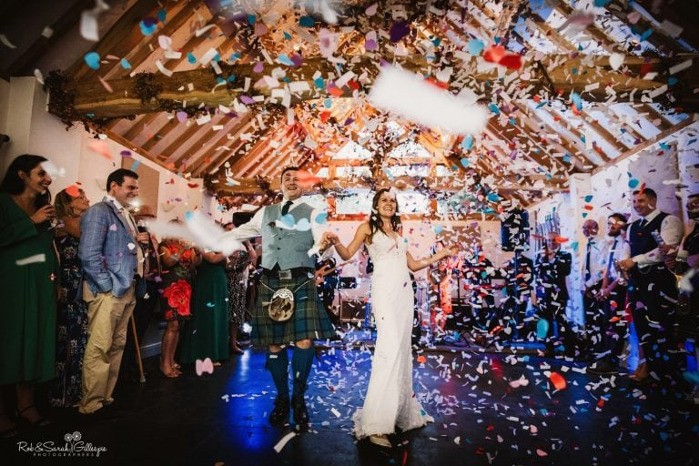 Bride and groom first dance with confetti bomb in barn at Wethele Manor
