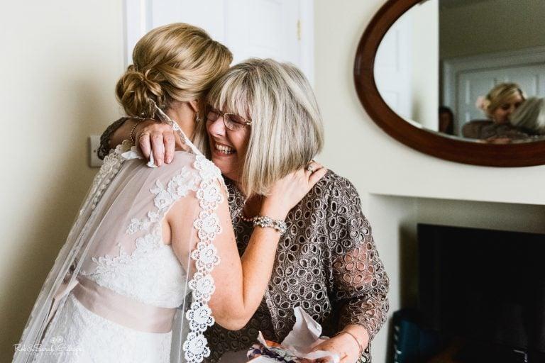 Bride and hugs before wedding