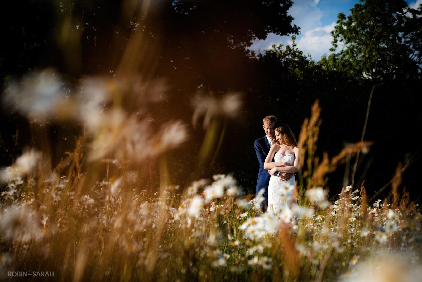 Bride and groom in beautiful field