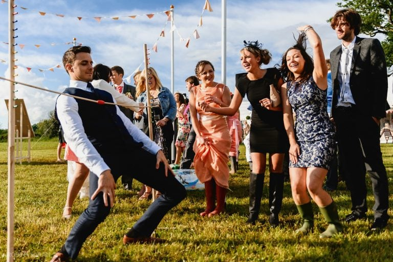 Wedding guests relax and limbo dance
