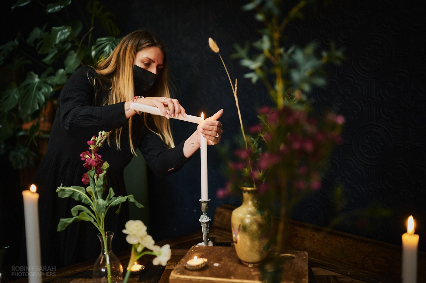 Staff light candles for wedding ceremony at The Chimney House