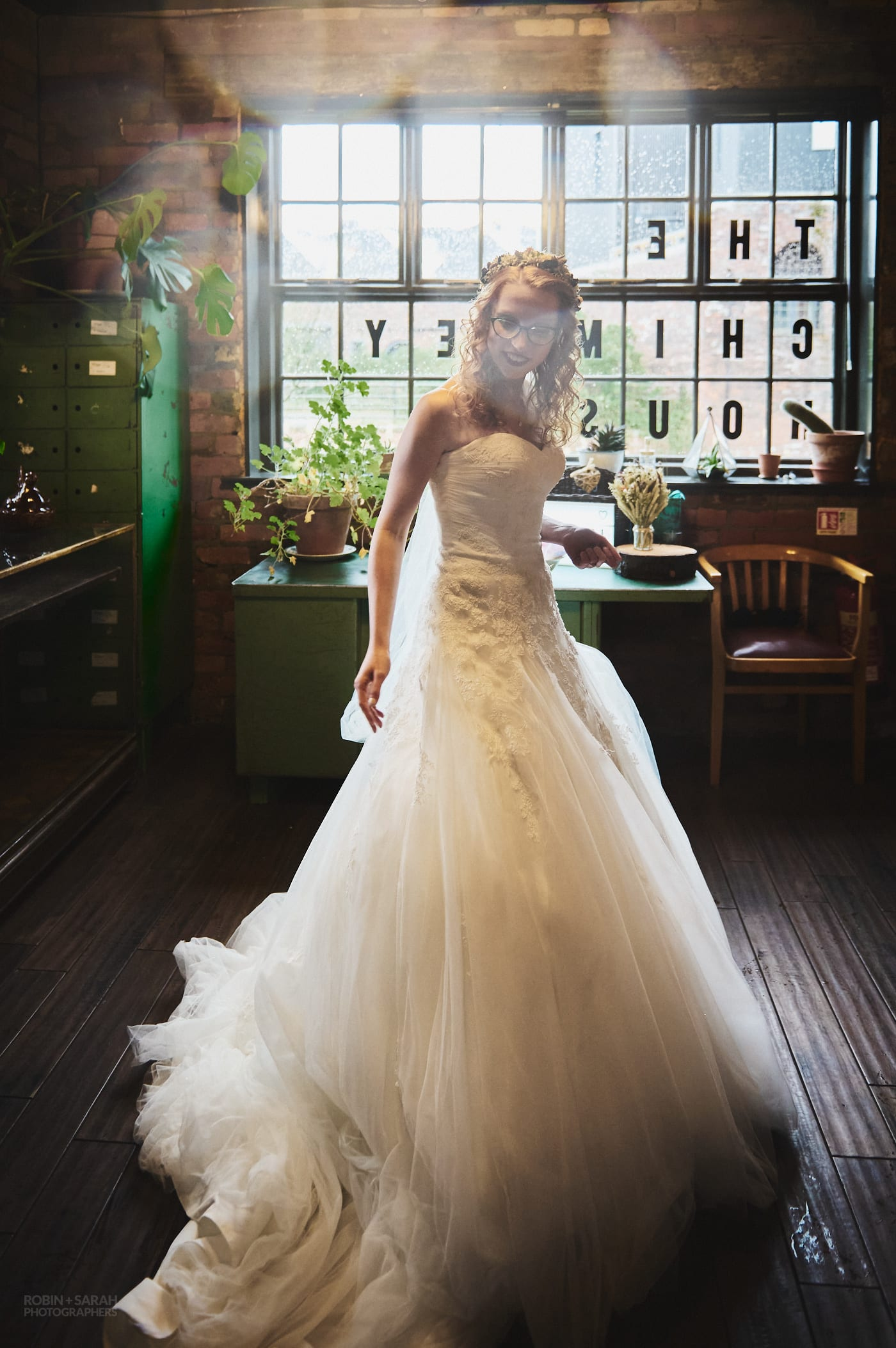 Bride swishes her wedding dress as she arrives for wedding at The Chimney House