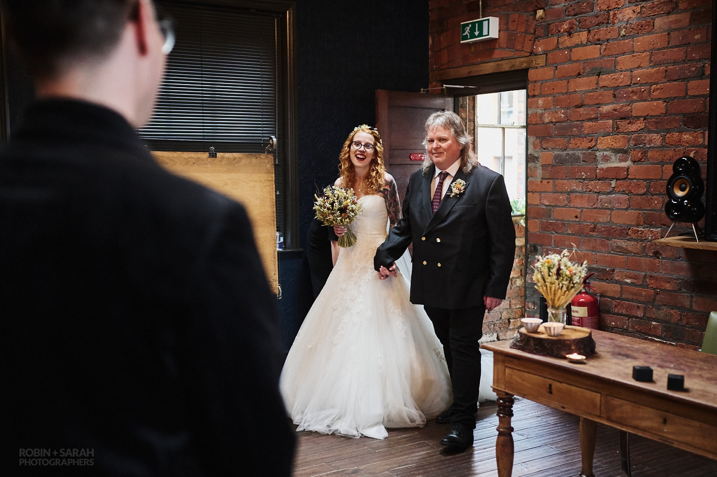 Bride and dad enter wedding ceremony at The Chimney House