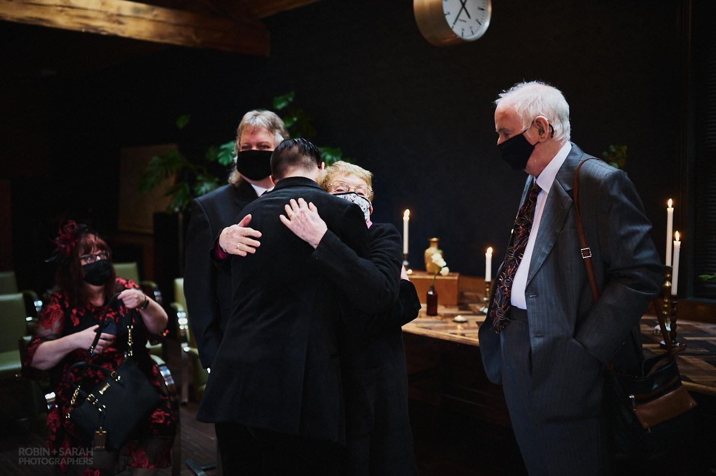 Wedding guest hugs groom after ceremony at The Chimney House