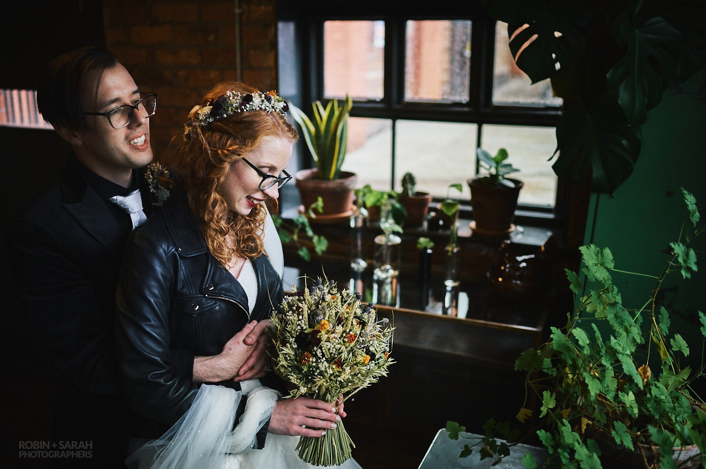 Newly married bride and groom cuddle up in The Chimney House