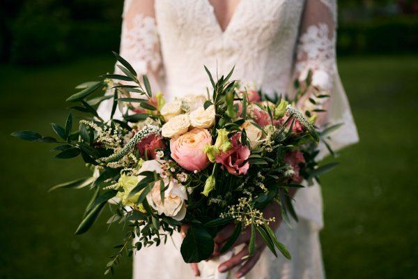 Detail of bride holding bouquet
