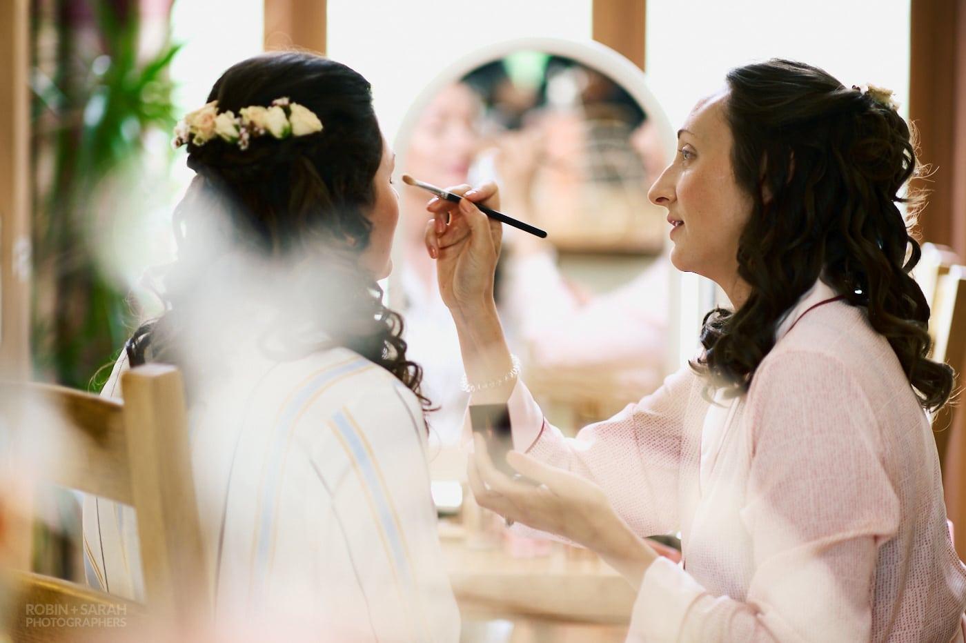 Bride has makeup applied