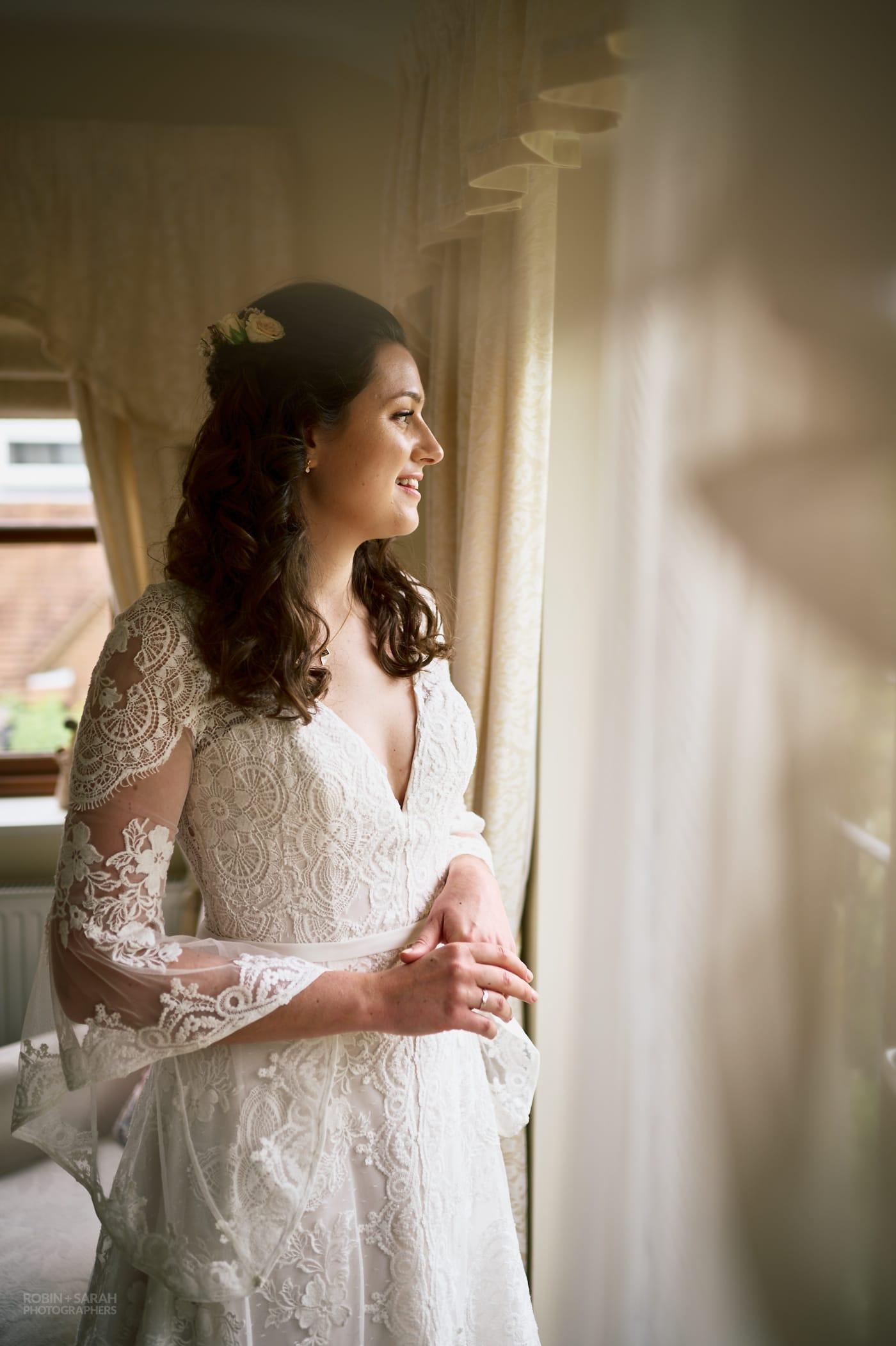 Portrait of beautiful bride in window light