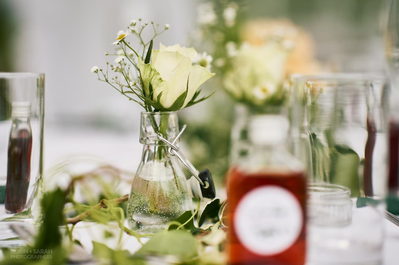 Yellow flower in small glass jar