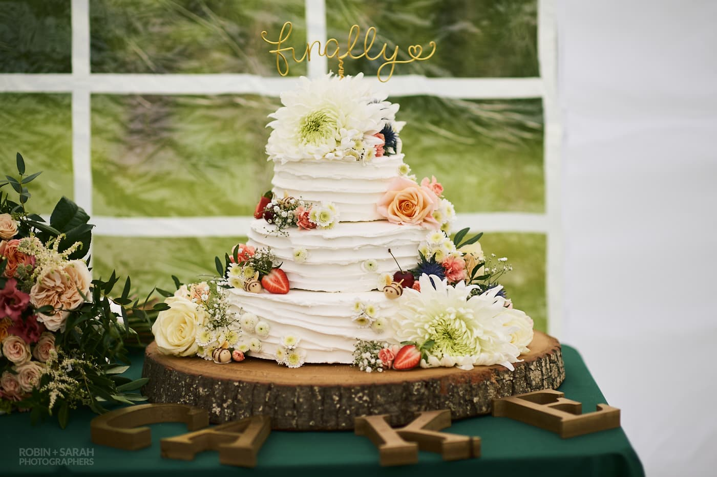 Home made wedding cake decorated with garden flowers