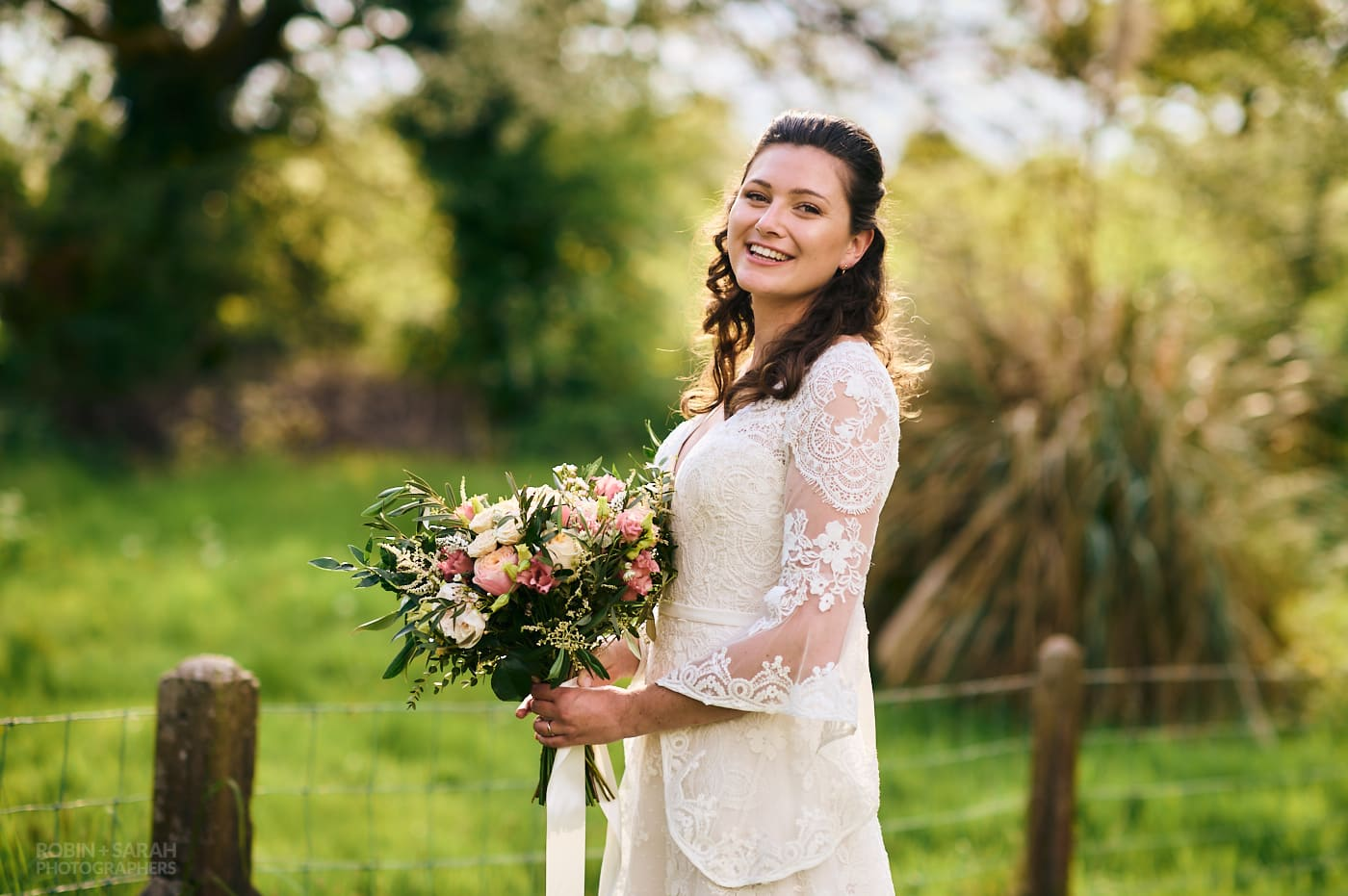 Bride holding bouquet happy and relaxed at garden wedding