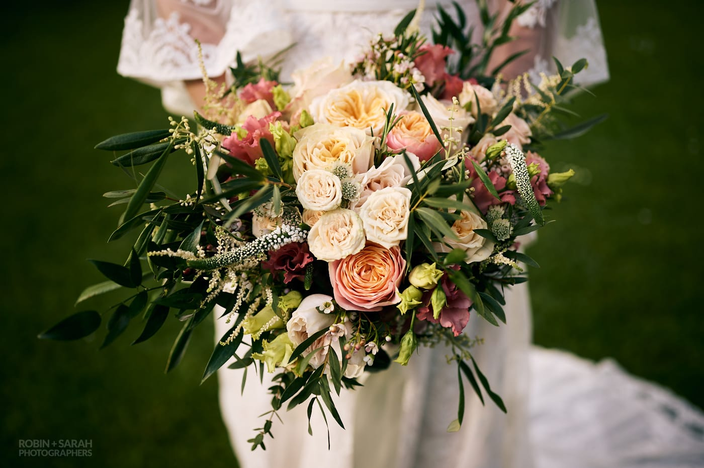 Beautiful wedding bouquet with peach and pink flowers