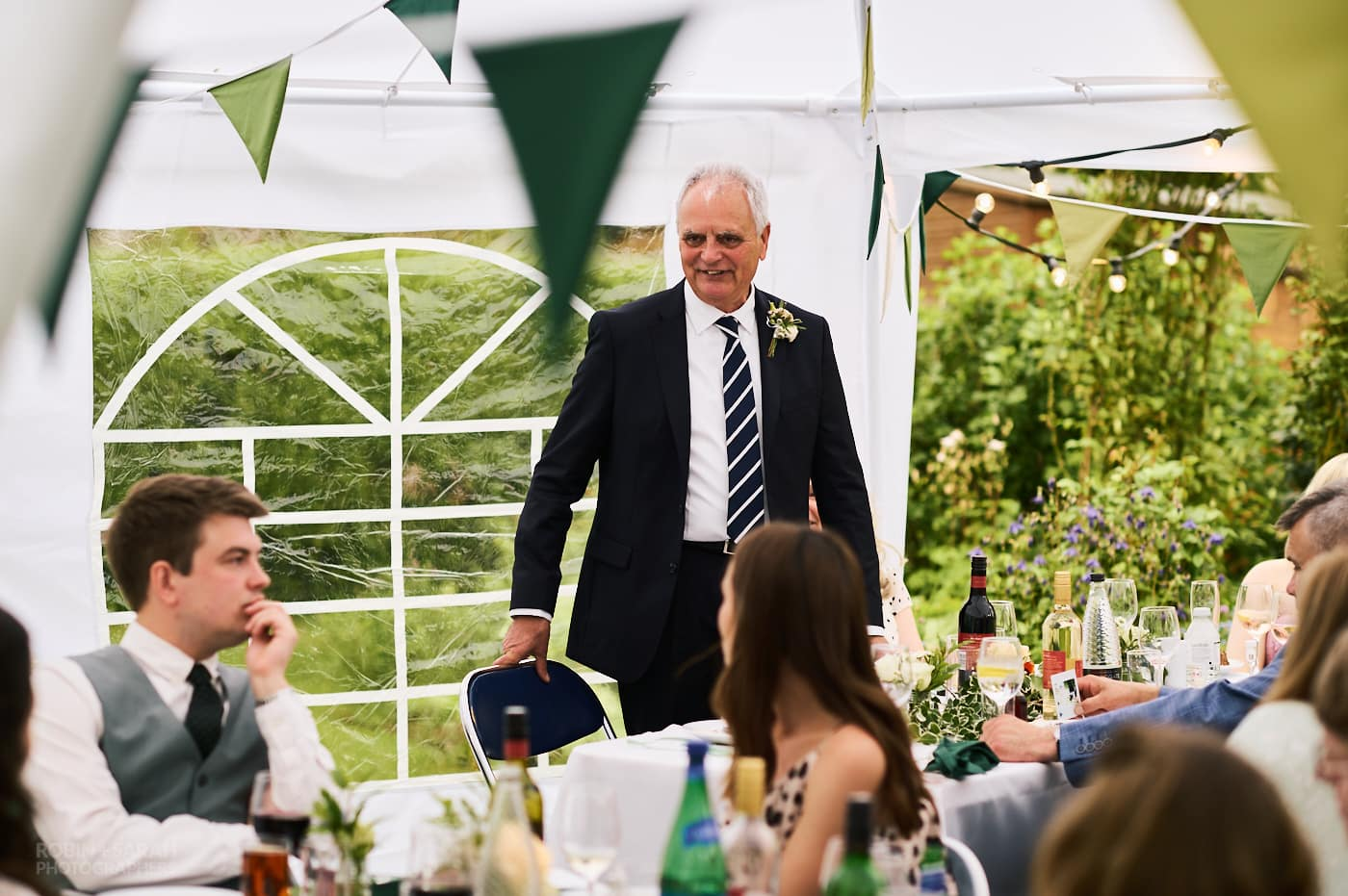 Bride's dad gives speech at garden wedding