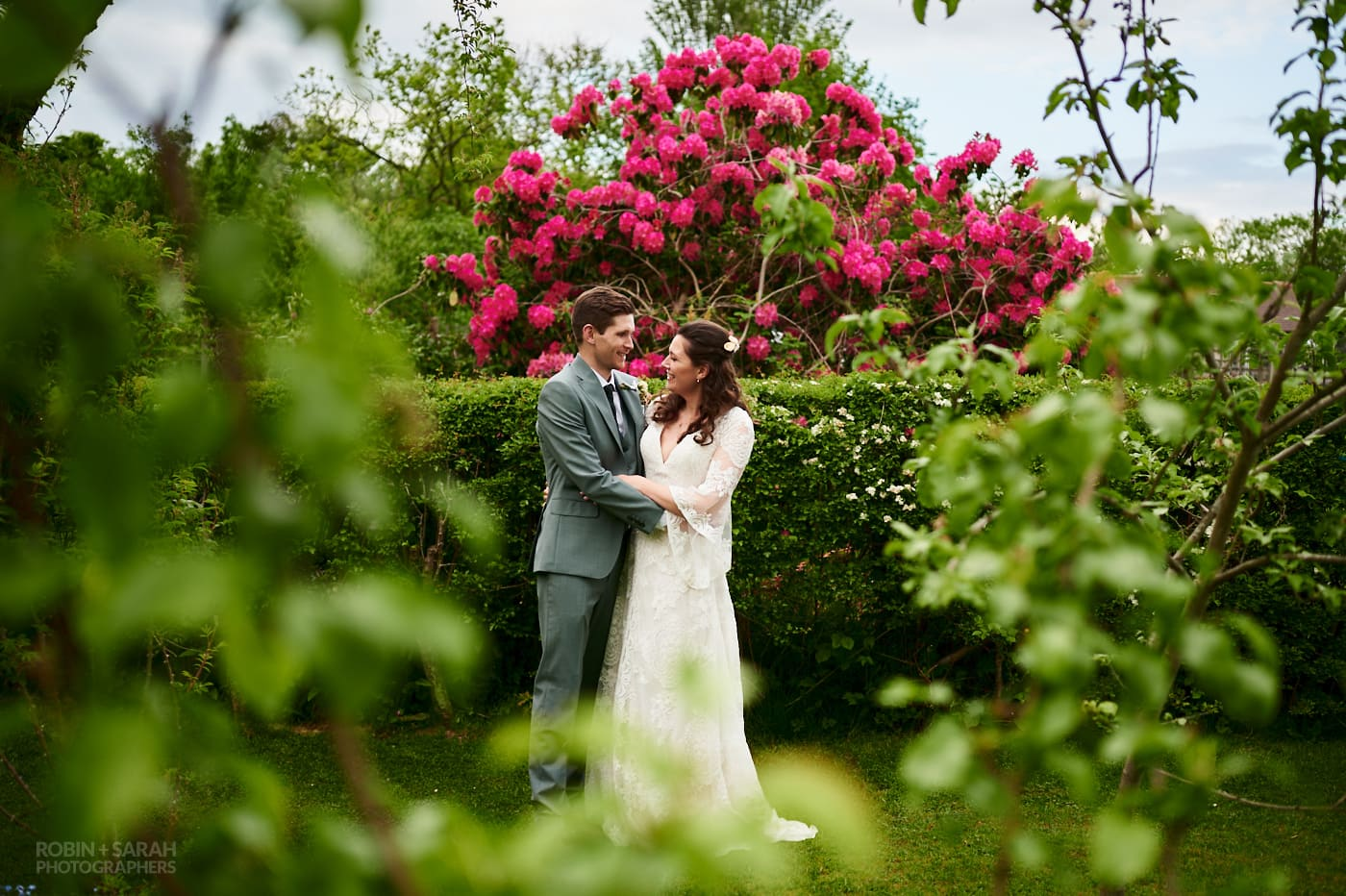 Bride and groom surrounded by beautiful gardens