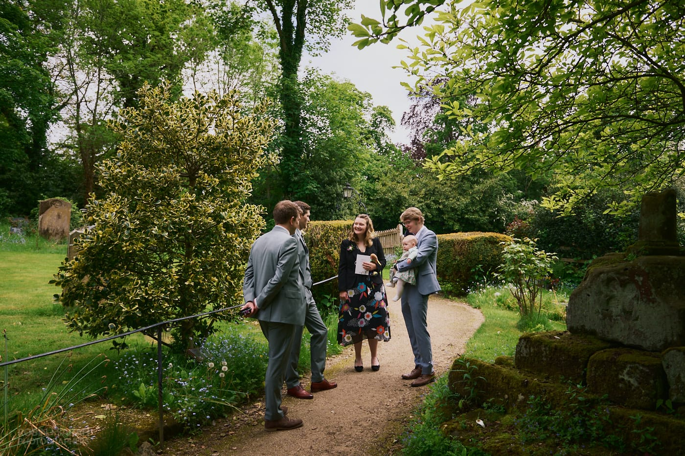 Groom chats to guests before wedidng at St Leonard's Beoley