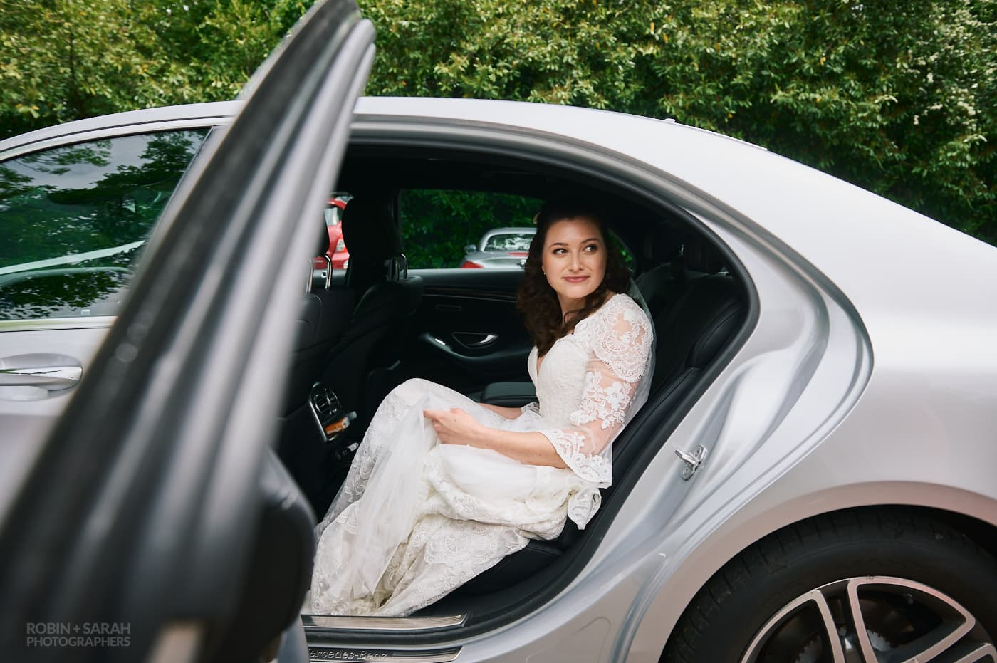 Bride looks out from wedding car