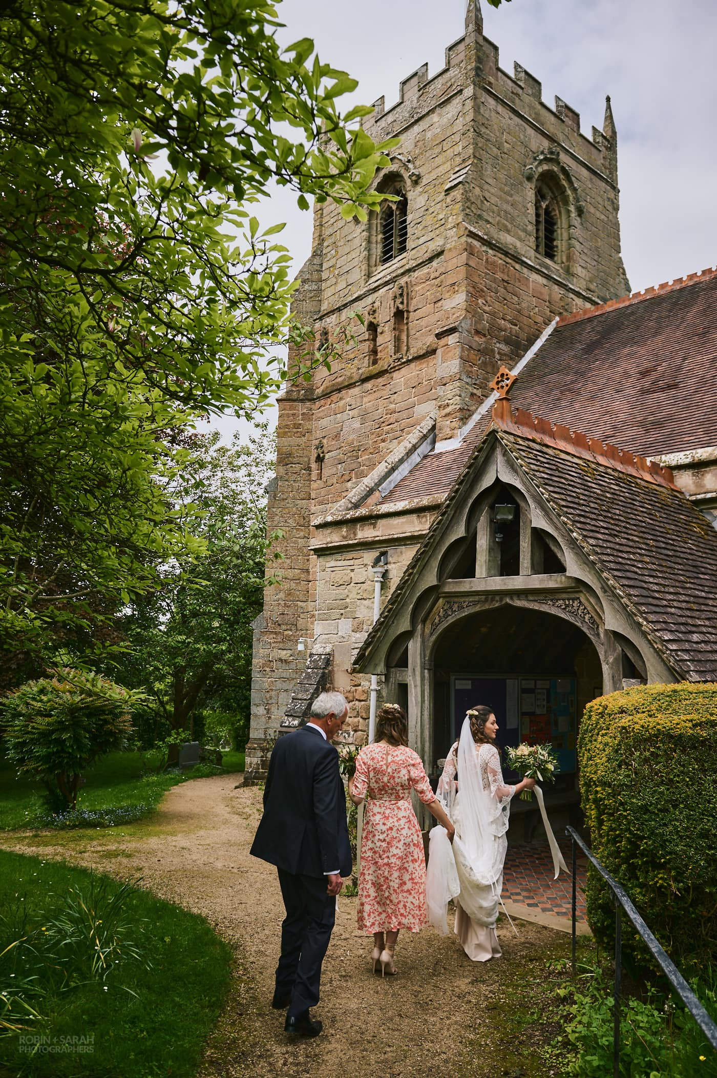 Bride, bridesmaid and dad arrive at St Leonard's church Beoley for wedding
