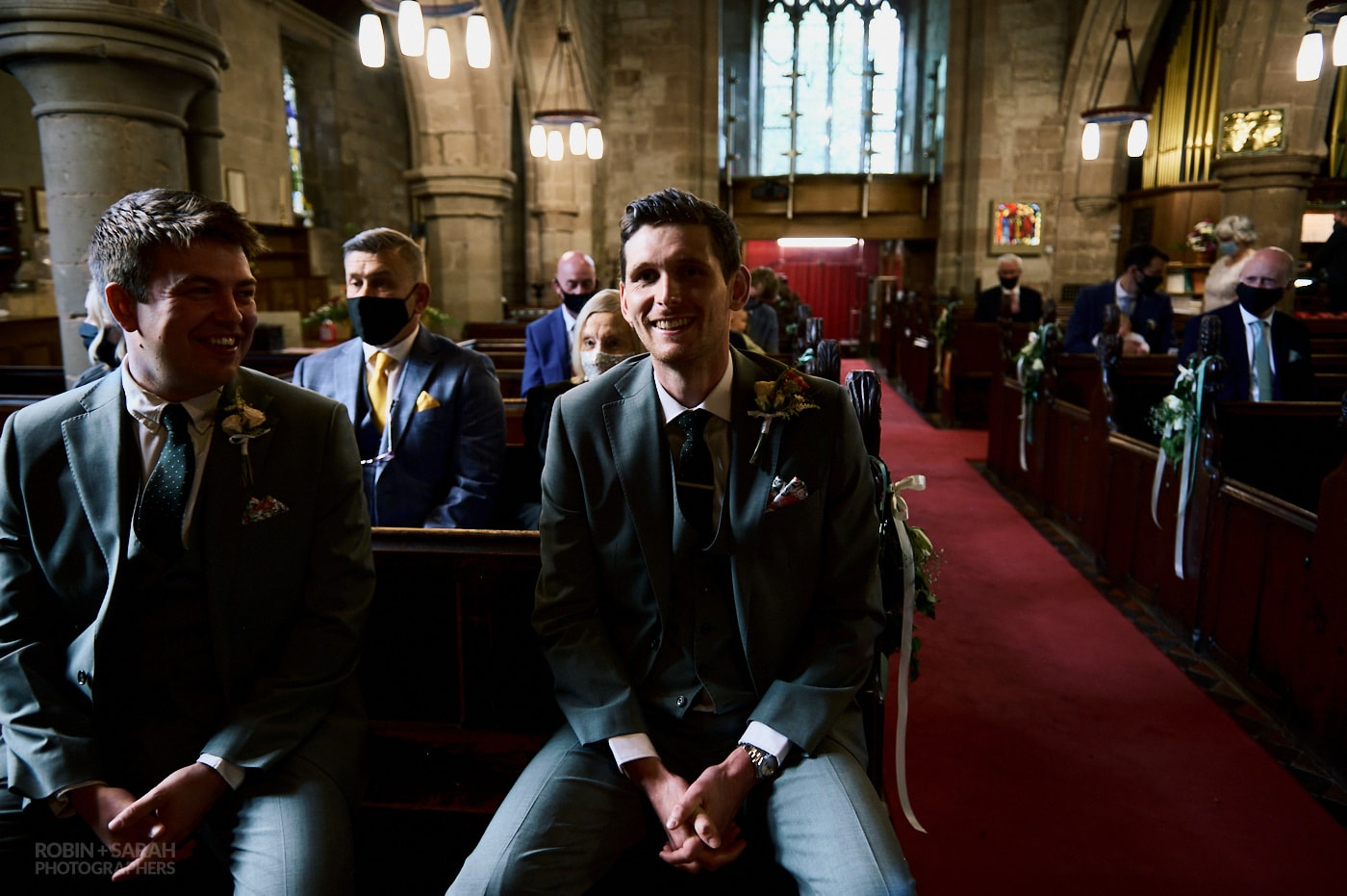 Groom and best man wait for bride and front of church
