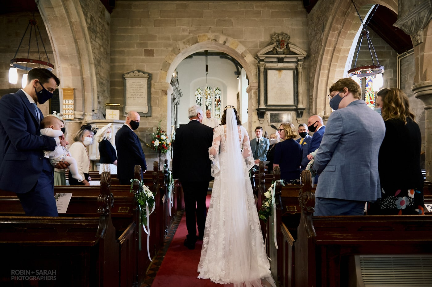 Bride and dad walk up aisle for wedding at St Leonard's Beoley